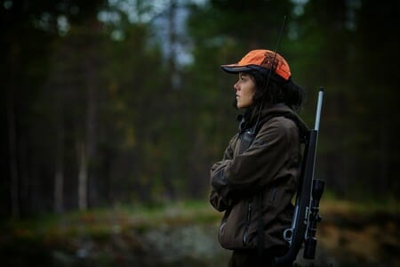 A women wearing a cold weather hunting jacket