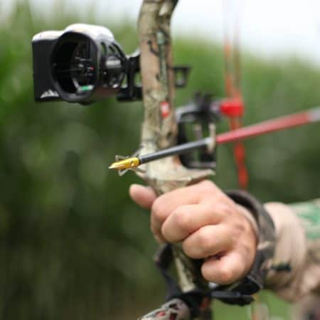 Man shooting with the best single pin bow sight